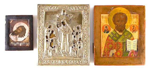 Icon of Mother of God Joy to All Who Grieves in brass cover, early 20th century, together with icon of St. Nicholas the Miracle Worker and Icon of John the Baptist