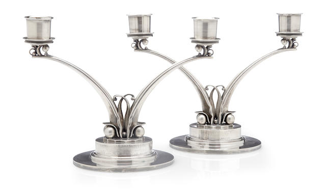 A pair of Danish sterling silver  two-light candelabra by Georg Jensen Silversmithy, Copenhagen, 1945 - 1977