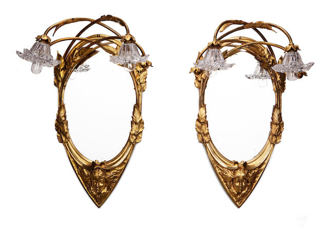 A pair of Louis Chalon gilt-bronze and glass figural sconces circa 1900