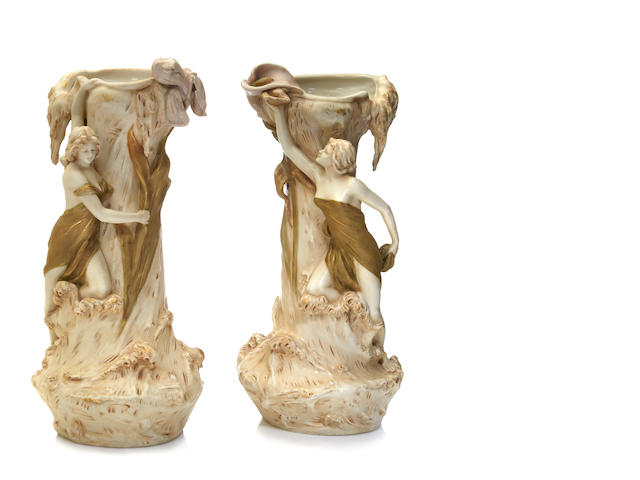 A matched pair of Royal Dux glazed ceramic figural vases circa 1900