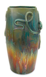 A Clement Massier glazed earthenware snakes and cattail vase circa 1900
