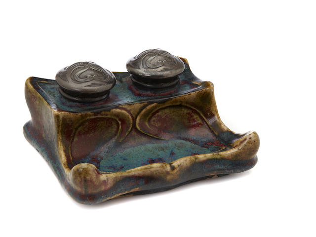 An Adrian Dalpayrat and Edouard Colonna glazed stoneware and pewter double inkwell circa 1900