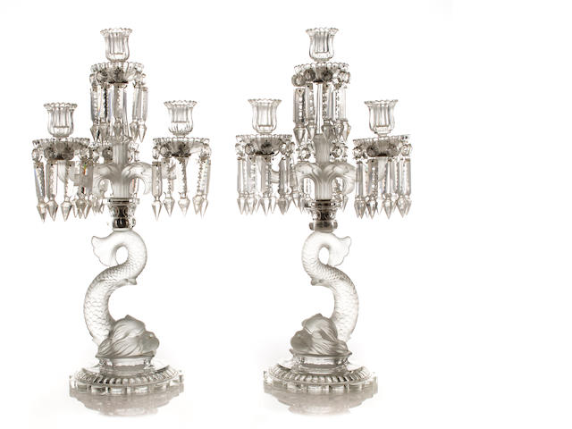 A pair of French partially frosted figural four-light candelabras, lacking one prism