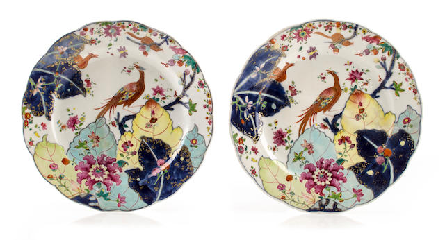 A pair of Chinese export porcelain tobacco leaf decorated plates