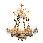 A gilt metal colored and clear glass eight light chandelier