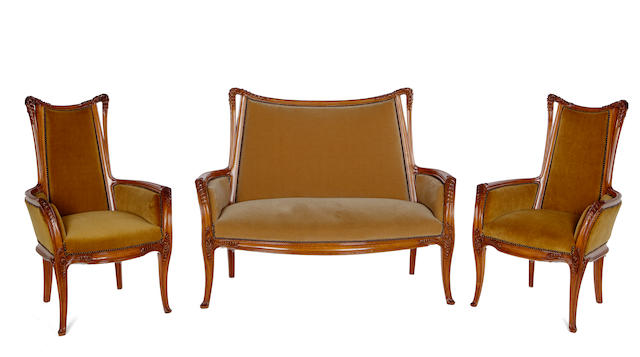 A fine Louis Majorelle walnut five-piece salon suite: Fougeres  circa 1900