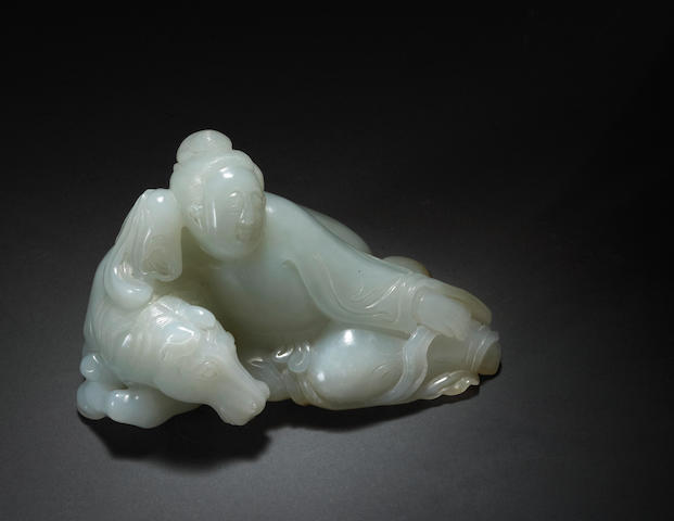 A white jade carving of a figural group