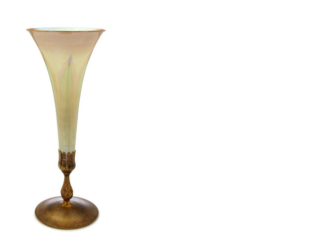 A Tiffany Studios gilt-bronze mounted decorated Favrile glass trumpet form vase circa 1910