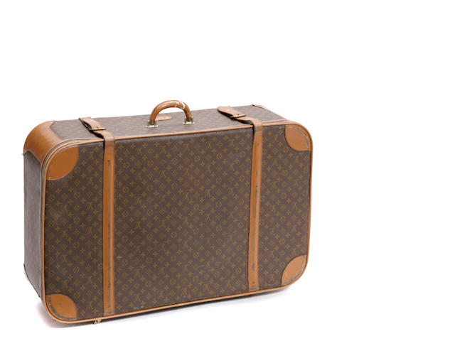 A Louis Vuitton soft sided suitcase