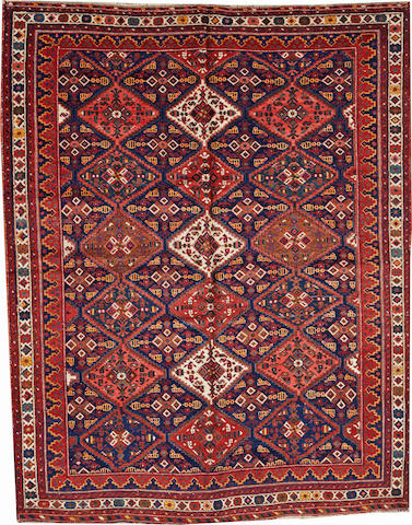 An Afshar rug Southwest Persia size approximately 5ft. 10in. x 7ft. 5in.