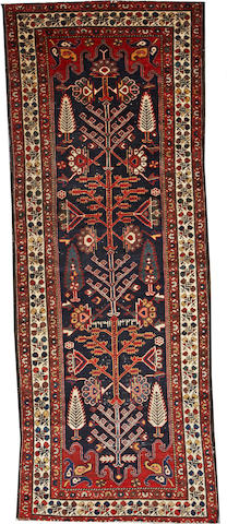 A Bakhtiari runner Southwest Persia size approximately 3ft. 6in. x 9ft. 4in.