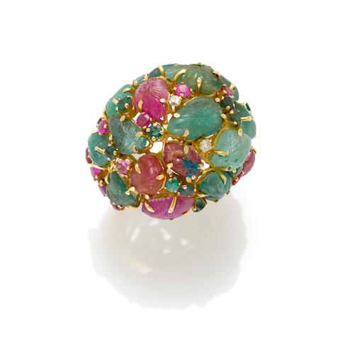 A carved, emerald, ruby and diamond ring