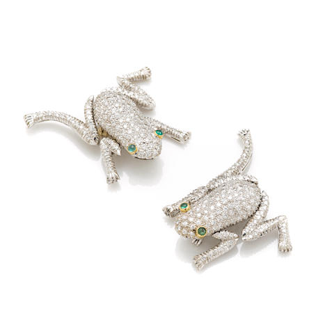 A pair of round brilliant cut diamond, emerald and 18 karat white gold 'frog' motif brooches