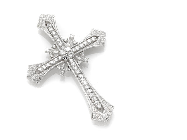 A round brilliant cut diamond and 18 karat white gold 'cross' motif pendant brooch