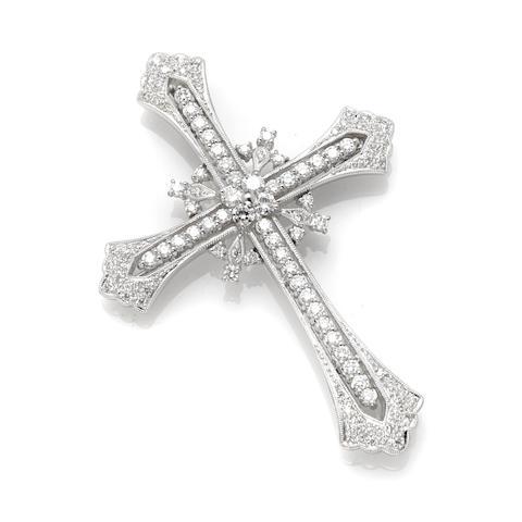 A round brilliant cut diamond and 18 karat white gold 'cross' motif pendant brooch