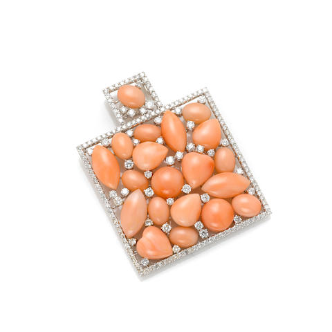 A coral, round brilliant cut diamond and white gold pendant