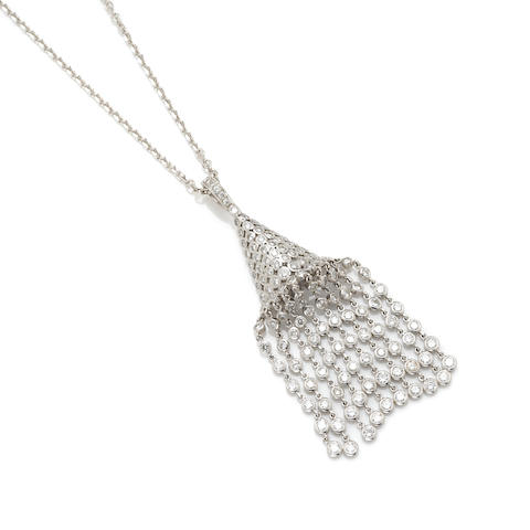 A round brilliant cut diamond and white gold articulated pendant with 14 karat white gold chain