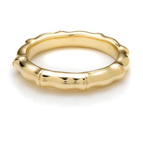 A 14k gold bamboo style satin finish bangle bracelet