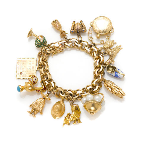 An enamel, cultured pearl and gold travel charm bracelet