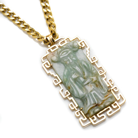 A carved jade pendant and gold frame together with an 18k gold chain