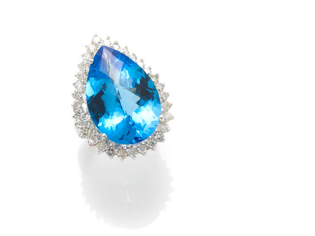 A topaz, diamond and 14k white gold ring