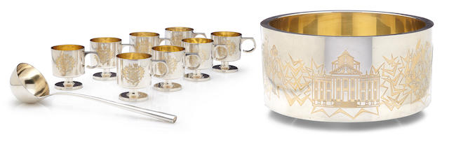 A John Churchill and Alex Styles for Garrard & Co. Ltd.  parcel gilt sterling silver  Sir Winston Churchill commemorative ten piece punch service London, 1974