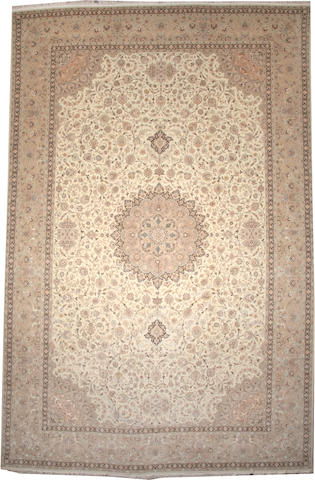 A Tabriz carpet  Northwest Persia size approximately 12ft. 9in. x 19ft. 10in.