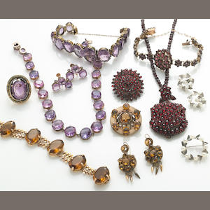 A group of 12 items including: 3 garnet items (necklace, brooch, bracelet), amethyst and enamel ring (some damage to enamel), amethyst bracelet, quartz bracelet, pin, earrings, silver pin and earrings, purple stone necklace and earrings (14k, silver)