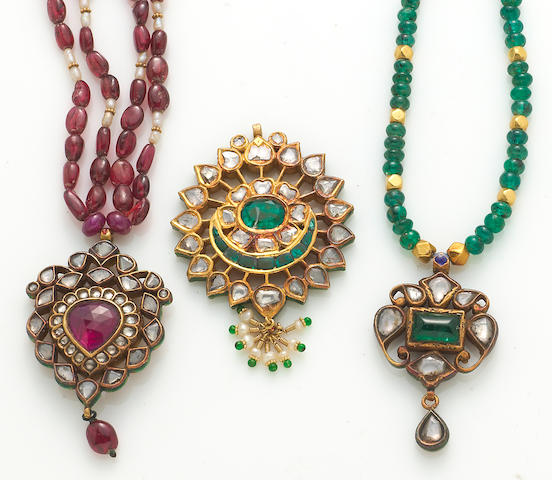 A collection of emerald, ruby, pearl, glass, enamel, gold and metal jewelry