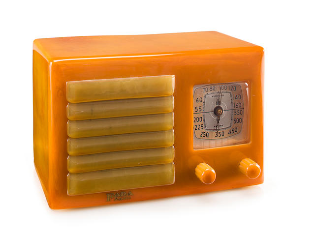 A Fada 5F60<BR />1936 Yellow case with onyx knobs and matching louvered grille.<BR />height 5 1/2in (14cm); length 8 1/4in (21cm); depth 4 1/2in (11.5cm)