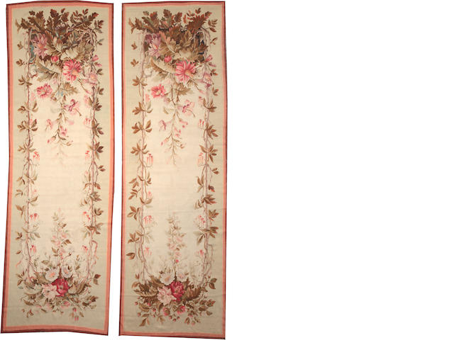 A Pair of Aubusson entrefenestres France sizes approximately 4ft. x 12ft. 3in.