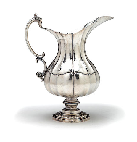 A Continental 800 standard silver water pitcher, in the Rococo style, with a hammered finish, height 11in, weight 29oz