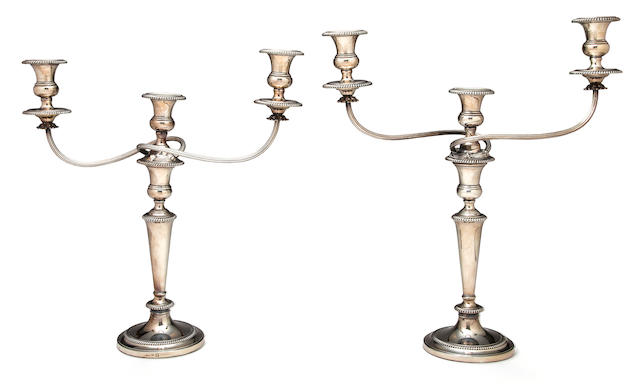 A pair of Sheffield plated three light candlesticks, 19in. high, 19in wide
