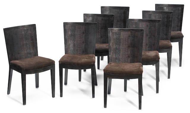 A set of eight Karl Springer stamped leather and suede dining chairs circa 1988