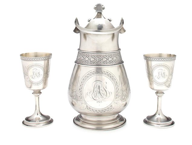 A Whiting sterling pitcher and two matching goblets