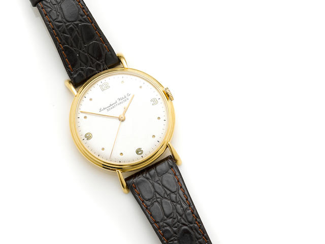 An 18k gold wristwatch, International Watch Co., with later leather and metal strap