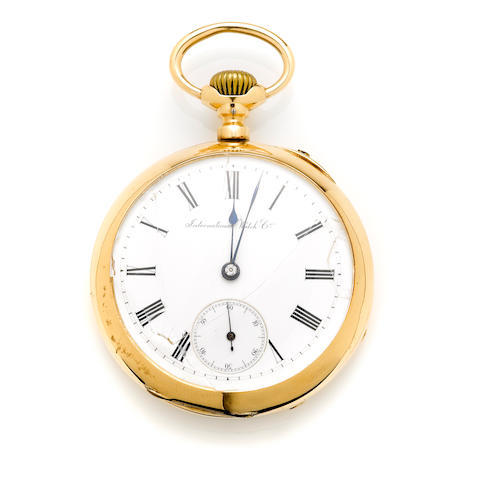 An 18k gold and metal open face pocket watch, International Watch Co.