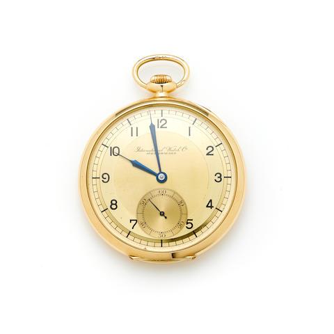 A 14k gold and metal open face pocket watch, International Watch Co.