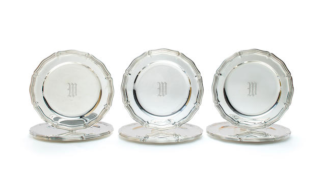 A set of twelve American sterling silver place plates<BR />manufactured and retailed by Tiffany & Co., 1907-47