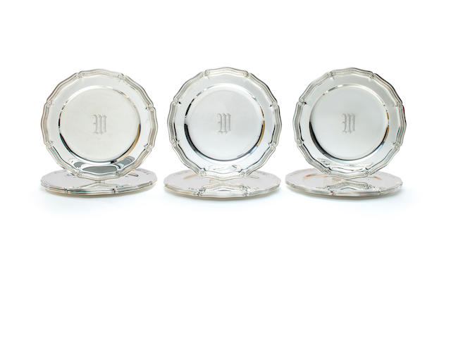 A set of twelve Tiffany & Co. sterling silver place plates