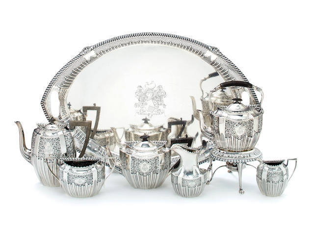 A Victorian sterling silver tea and coffee service, James Dixon & Sons, Sheffield, circa 1898-99, comprising a coffee pot, a teapot with ebony handles, a hot water kettle on stand, a sugar bowl, creamer, milk jug (handle damaged) and a tray. approx. 200oz troy