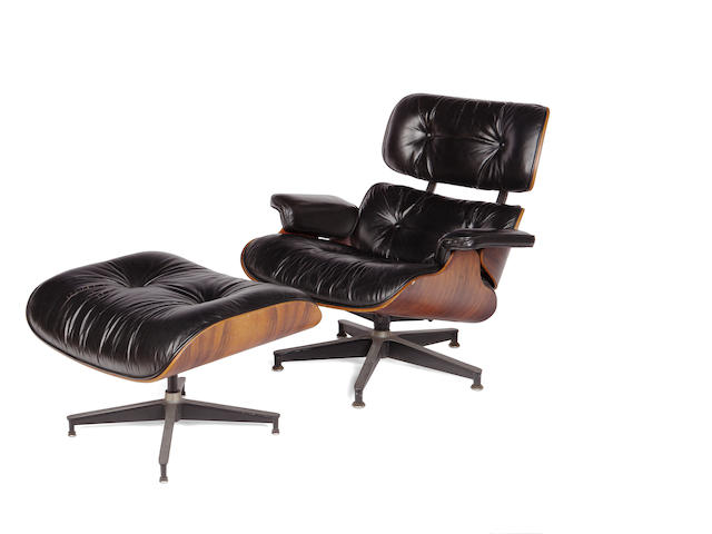 A Charles and Ray Eames for Herman Miller rosewood and leather lounge chair and ottoman models 670 and 671, designed 1956