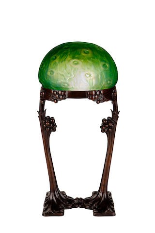A Gustave Gurschner and Loetz patinated-bronze and iridescent glass lamp circa 1900
