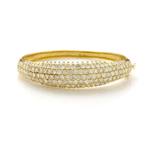 A diamond and 14k gold bangle