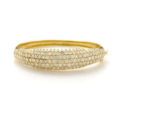 A 7 row diamond and gold bangle
