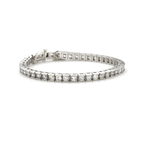 A diamond and 14k white gold bracelet
