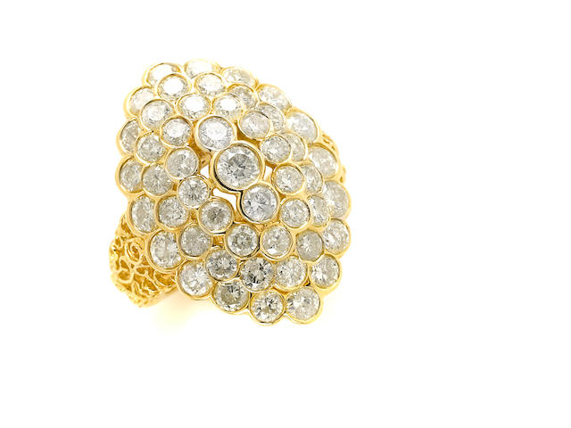 A colored diamond and 14k gold cluster ring