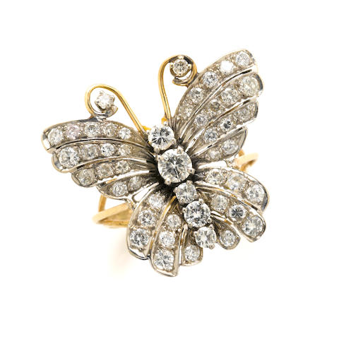 A diamond and gold butterfly ring
