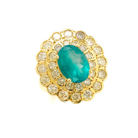 An oval emerald, diamond and 18k gold ring