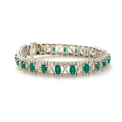 An oval emerald, diamond and white gold bracelet